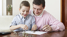 Read the article: Do you know how to talk to your kids about money?